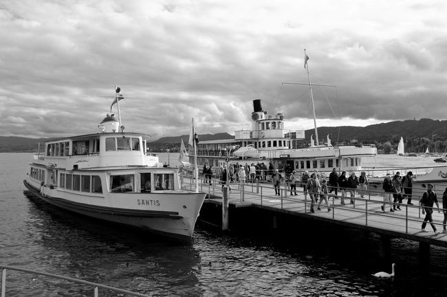 Black & White Nature Transportation Beauty In Nature Black And White Cloud - Sky Darkness And Light Fujifilm_xseries Harbor High Contrast Incidental People Lake Lake View Lake Zürich Mode Of Transport Monochrome Moored Motor Boat Nautical Vessel Outdoors Paddle Steamer Red Filter Travel Destinations Water Waterfront