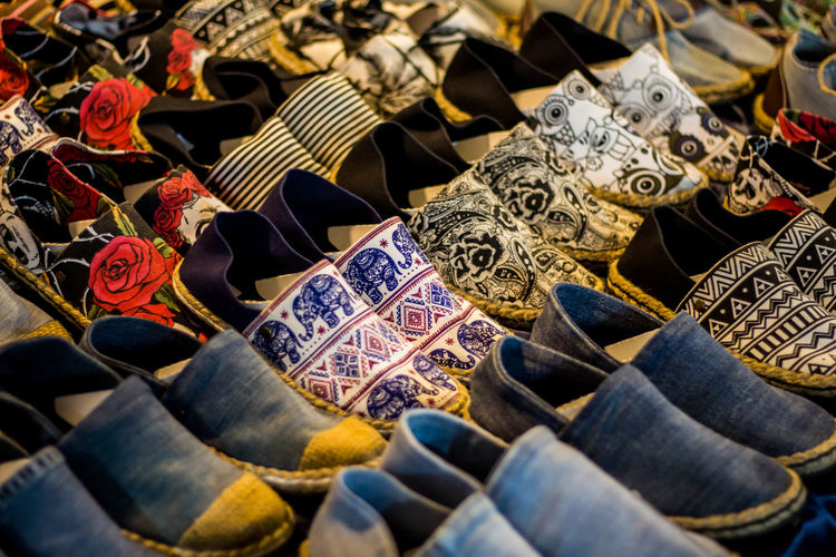 Large Group Of Objects For Sale No People Representation Market Retail  High Angle View Day Variation Selective Focus Abundance Choice In A Row Still Life Retail Display Arrangement Human Representation Market Stall Art And Craft Creativity Shose Popular Photos Popular Vintage Colorful