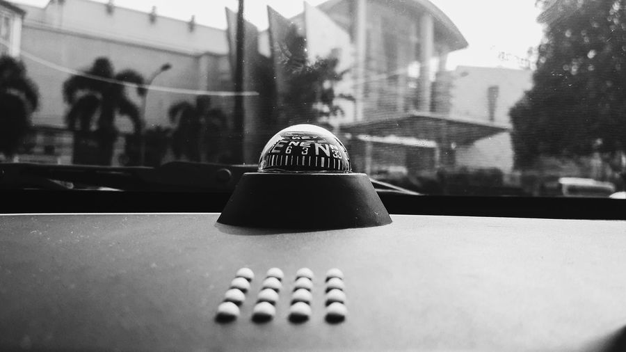 Close-up of ball on table in city