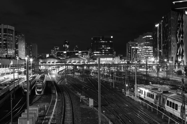Architecture Built Structure City City Life City Street Cityscape Development Diminishing Perspective Illuminated Modern Night No People Outdoors Railroad Track Sky The Way Forward Vanishing Point