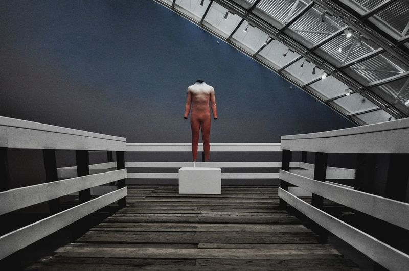 Digital composite image of person standing on pier