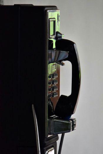 Telephone over white background