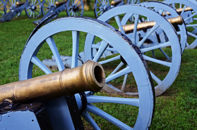 Artillery Cannon Circle Close-up Field Focus On Foreground Geometric Shape Grass Green Color Historic Historical History Land Metal Nature No People Outdoors Plant Spoke Wagon Wheel Wheel