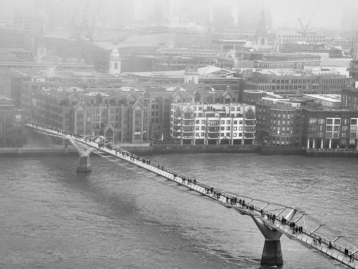 Aerial view of bridge over river in city