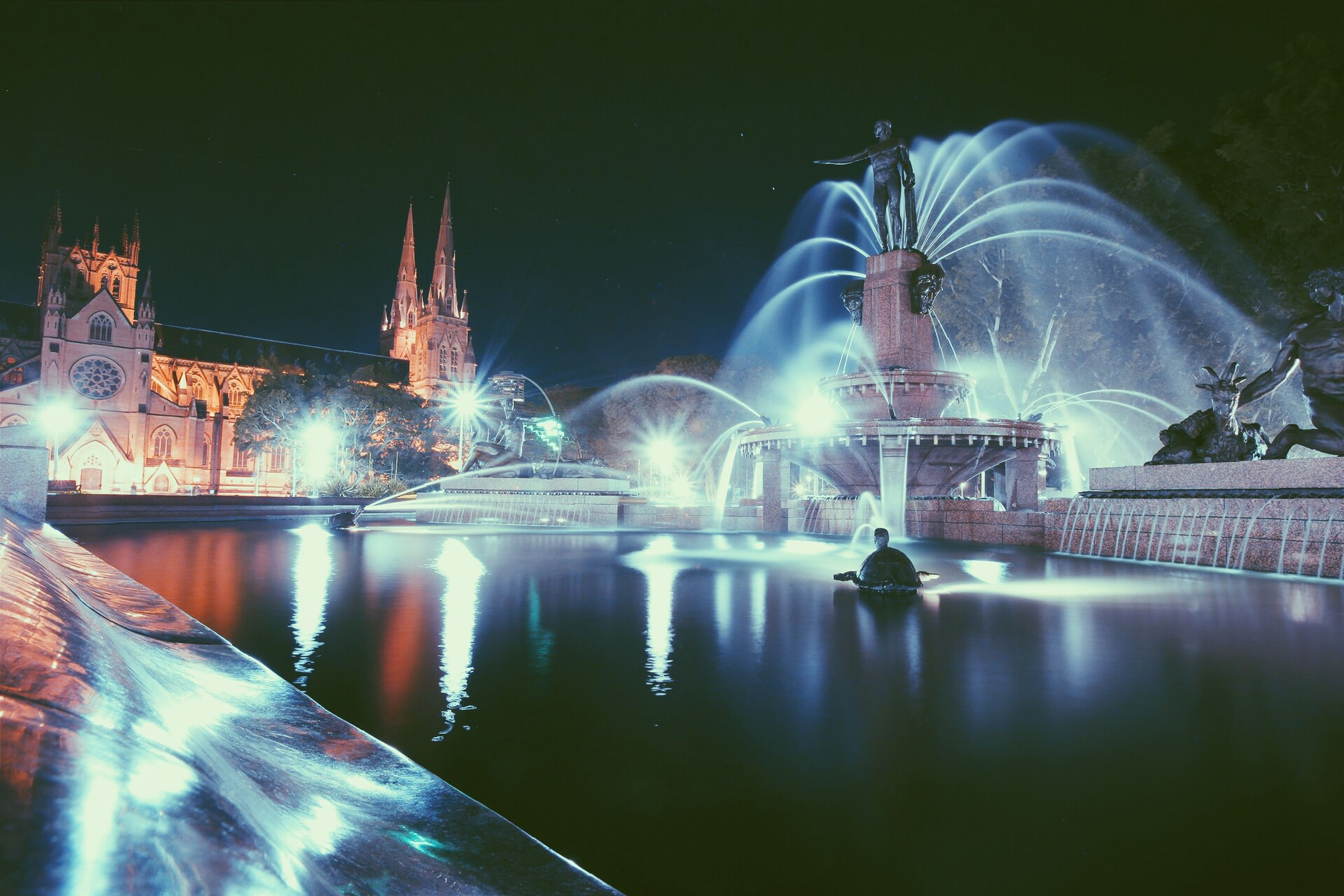 architecture, water, built structure, famous place, international landmark, reflection, travel destinations, building exterior, capital cities, tourism, night, fountain, city, illuminated, travel, river, waterfront, modern, spraying, clear sky