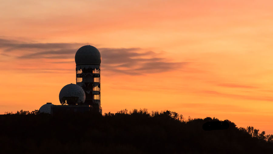 Abandoned Places Devils  NSA Silhouette Station Abandoned Architecture Beauty In Nature Building Exterior Built Structure Mountain Nature No People Orange Color Outdoors Radar Station Scenics Silhouette Sky Sunset Technology Telecommunications Equipment Teufelsberg Tree Urbex #FREIHEITBERLIN