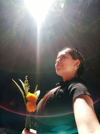 Portrait of woman in sunlight on sunny day
