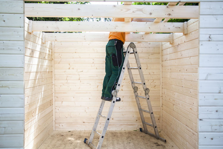 Confidence  Construction DIY Do It Yourself Goals Home Improvement Ladder Man Mission Self-Improvement Worker Building Building Site Endeavour Garden Goal Home Improvements Progress Project Protection Safety Wood - Material Wooden Construction Wooden House Working