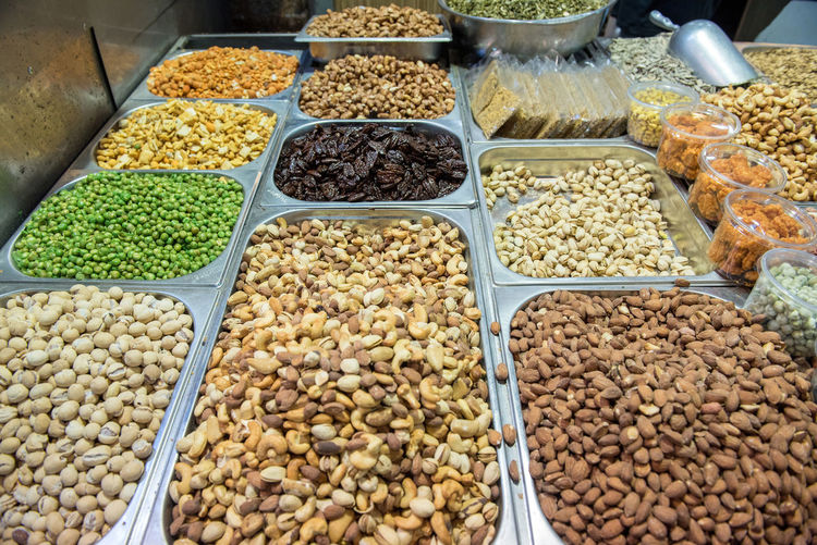 Collection of dried nuts, pistachio and seeds at oriental market, bazaar Food And Drink Food Freshness Market Retail  For Sale Abundance Nuts Seeds Dried Fruits Market Bazaar Oriental Pistachio Almonds Sunflower Seeds Walnuts Peanuts Healthy Eating Organic Food Fruits Middle Eastern Food Vegan Food Yehuda Market