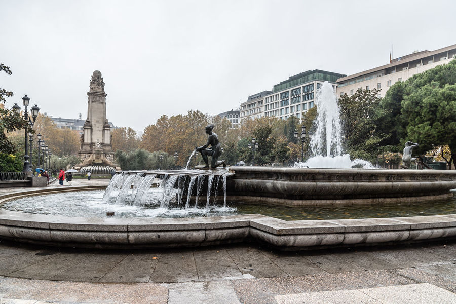Park in the Square of Spain in Madrid with Cervantes Monument Architecture Cervantes City Day Foggy Fountain Misty Monument Outdoors Park Park - Man Made Space Peace Plaza Plaza De España Rain Rainy Rainy Days Skyline Square Travel Travel Destinations Tree Urban Urban Skyline Water