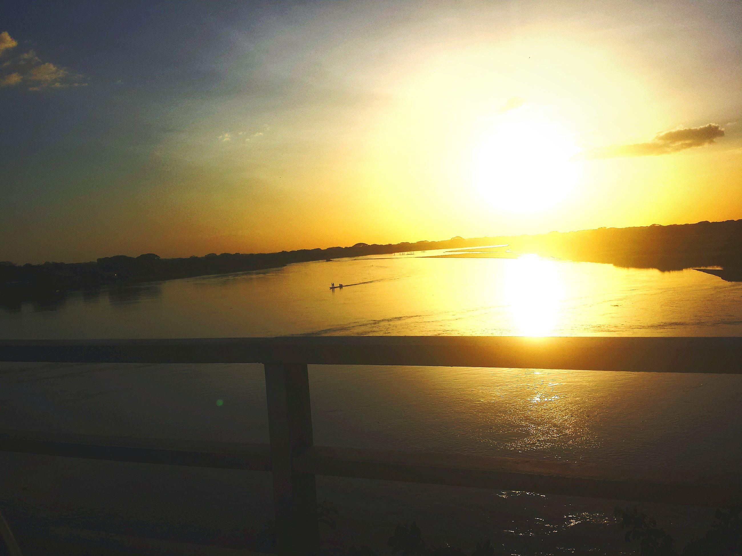 sunset, sun, water, sea, scenics, tranquil scene, reflection, tranquility, beauty in nature, horizon over water, sky, orange color, idyllic, sunlight, beach, nature, shore, silhouette, sunbeam, lake