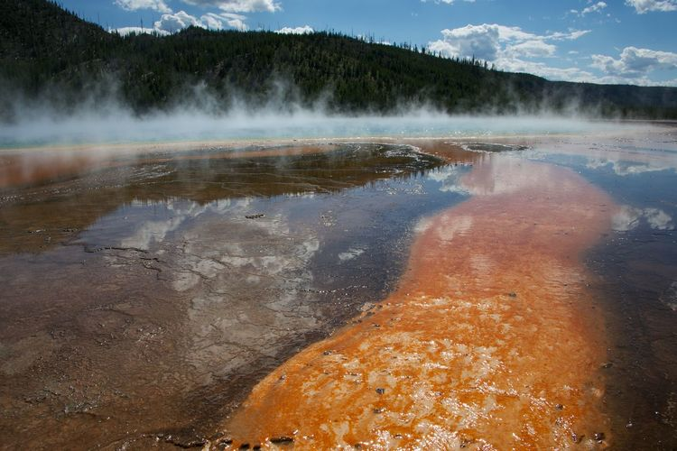 Geyser Emitting Smoke At Yellowstone National Park