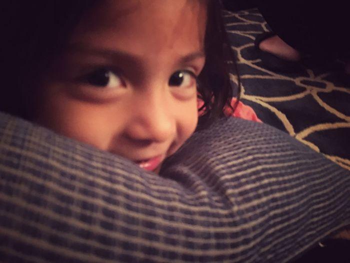 Smiling girl laying on pillow. Kids Smiling Smile Children
