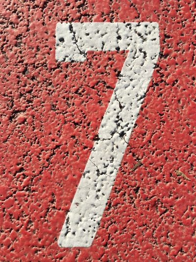 Directly above shot of number seven painted on street