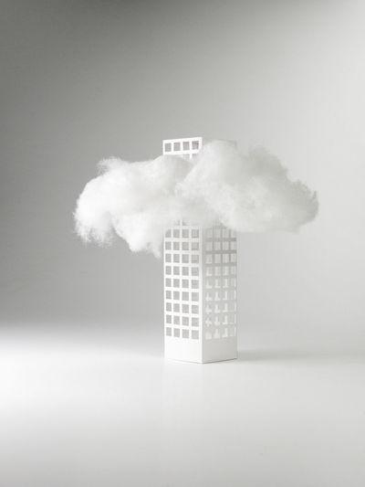 Digital composite image of sign against sky