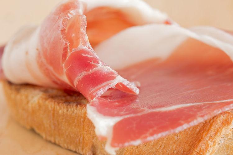 A slice of ham on a bruschetta.