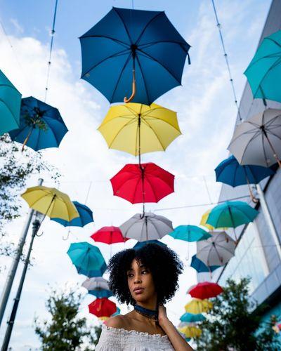 Woman holding colorful umbrella