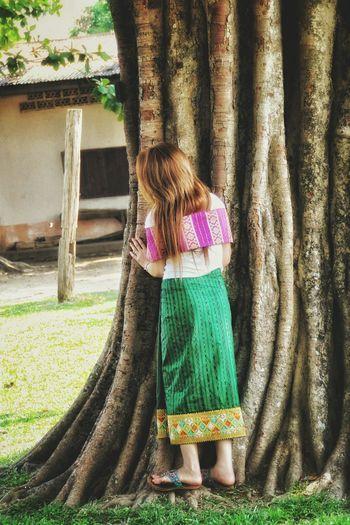What's behind the tree Girl Woman Tree Beauty Laos LaoStyle Peekaboo Enjoying Life Life Dress