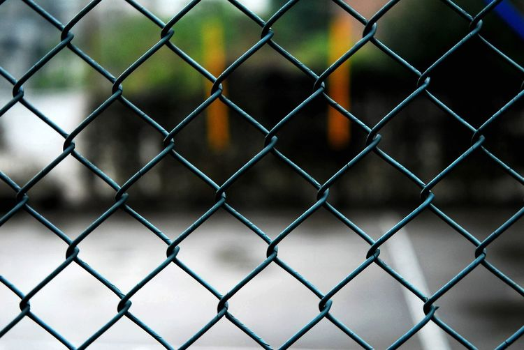 Fence Chainlink Fence Barrier Boundary Security Protection Safety Focus On Foreground Close-up Metal No People Day Backgrounds Nature Outdoors Pattern Crisscross Sport Full Frame Playing Field