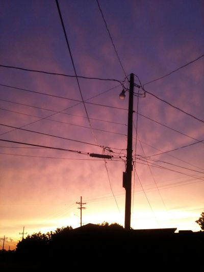 Beauty In Nature Cloud Cloud - Sky Connection Dark Electricity  Landscape Low Angle View Nature No People Orange Color Outdoors Power Cable Power Line  Purple Scenics Silhouette Sky Skyscape Sun Sunset Tranquil Scene Tranquility Showcase June