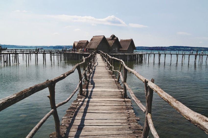 Pfahlbauten Pfahlbauten Pfahlbautenmuseum Bodensee Colorsplash Nature Photography Beauty In Nature Human History Wooden Wooden Construction Blue My Point Of View Water Bridge - Man Made Structure Pier Sky Architecture Horizon Over Water Building Exterior Built Structure Civilization Coastline Calm