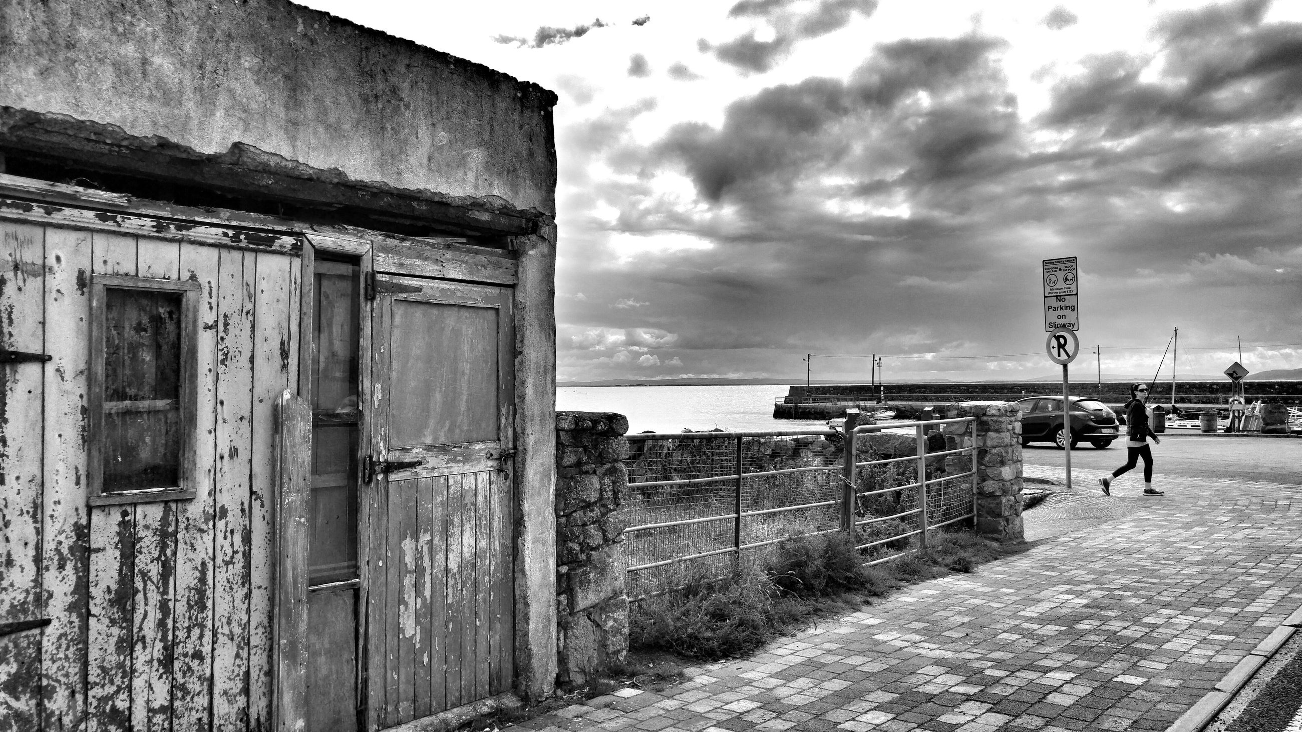 sky, built structure, architecture, cloud - sky, building exterior, cloudy, sea, abandoned, cloud, horizon over water, beach, old, day, outdoors, damaged, wood - material, weathered, obsolete, no people, water