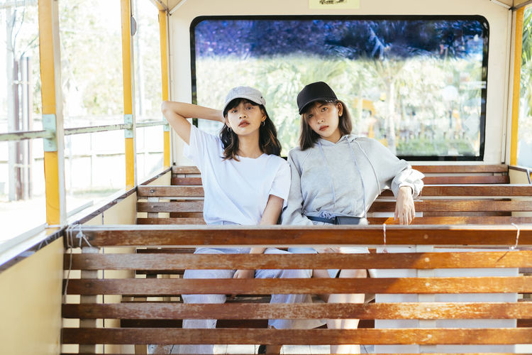 Portrait of friends sitting in toy train