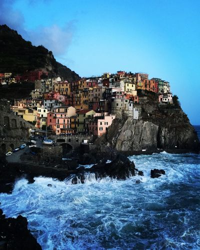 Stop and stare Painted Houses Ocean Coastline Tranquility Cinque Terre Italy Architecture Building Exterior Sea Built Structure Rock - Object No People House Blue Outdoors Mountain Day Sky Motion Clear Sky Water Wave Nature
