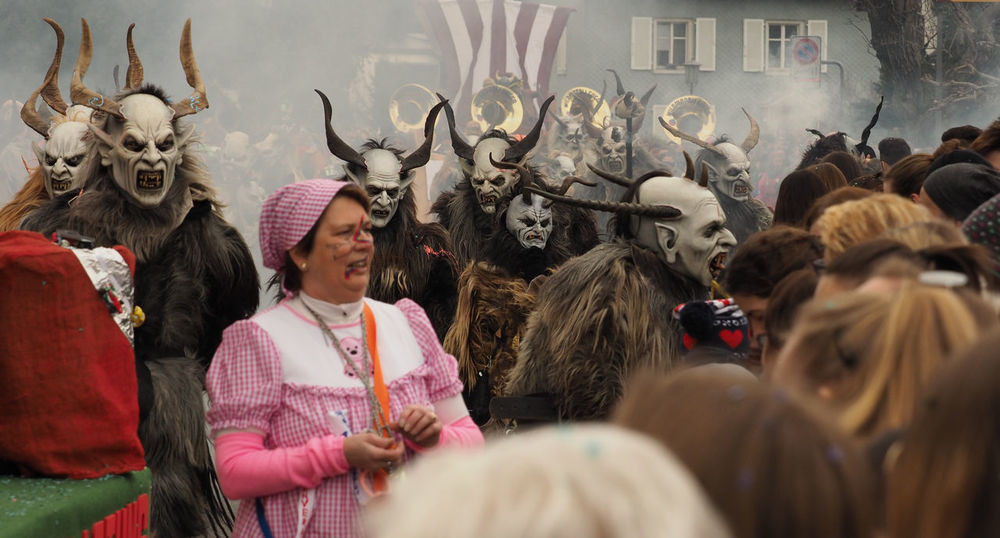 Don't look back! Carnival Carnival Crowds And Details Celebration Costumes Crowd Cultures Disguise Don't Look Back Fasnacht 2017 Joderteifel Large Group Of People Liechtenstein Lifestyles Mask - Disguise Masks Olympus OM-D E-M1 Mark II Outdoors Parade People Real People Smoke Tradition Traditional Festival Triesenberg Wild Creatures