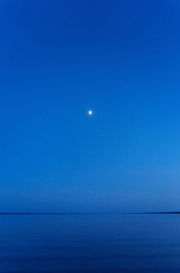 Moon Blue Sea Scenics Tranquil Scene Nature Beauty In Nature Night Clear Sky Horizon Over Water Water Outdoors EyeEmBestPics EyeEm Best Shots EyeEm Best Edits The Week On EyeEm Horizon Minimalobsession Minimalism Minimal Mood
