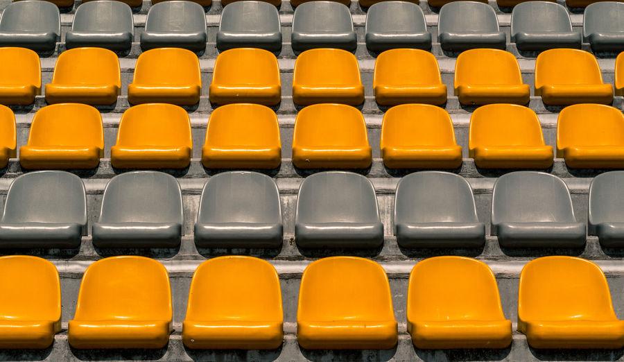 Full frame shot of empty  stadium chairs