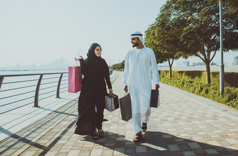 Couple walking on footpath