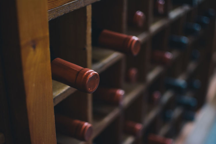 Some wine bottles on a shelf. Bottle Close-up Depth Of Field Drink Red Santiago De Chile Selective Focus Still Life VSCO Vscocam Wine Wine Tasting Winery