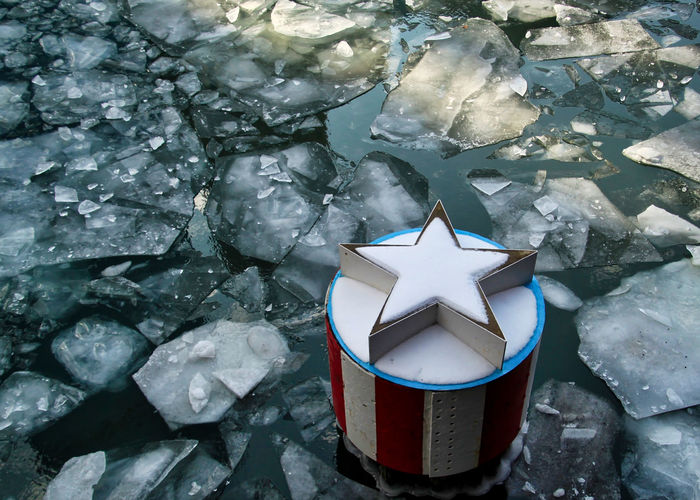 Star on post in a frozen, ice filled Chicago River, in Chicago Loop on a frigid day in January. American Blue Color Chicago River Chicago Loop Downtown Chicago Frozen January Winter Close-up Cold Temperature Day Floating On Water Frigid Frozen Water Ice Chunks Icy Nature No People Outdoors Red Color Red White And Blue Snow Snow Covered Star Water Shades Of Winter