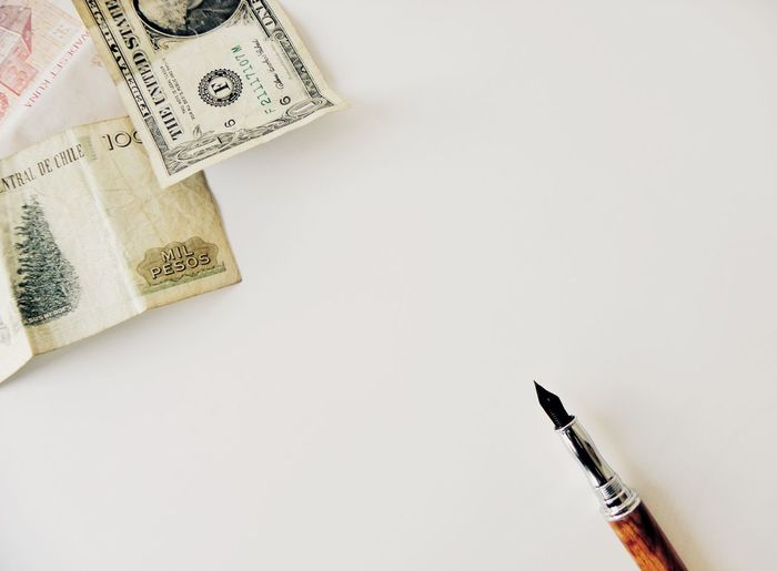 White Background Indoors  Studio Shot No People Close-up Day Ink Well Paper Sheet Paper Paper Currency Pen Wealth Finance Light Money Around The World Business Finance And Industry Currency High Angle View Fountain Pen Money Ink Copy Space Office Clear Background