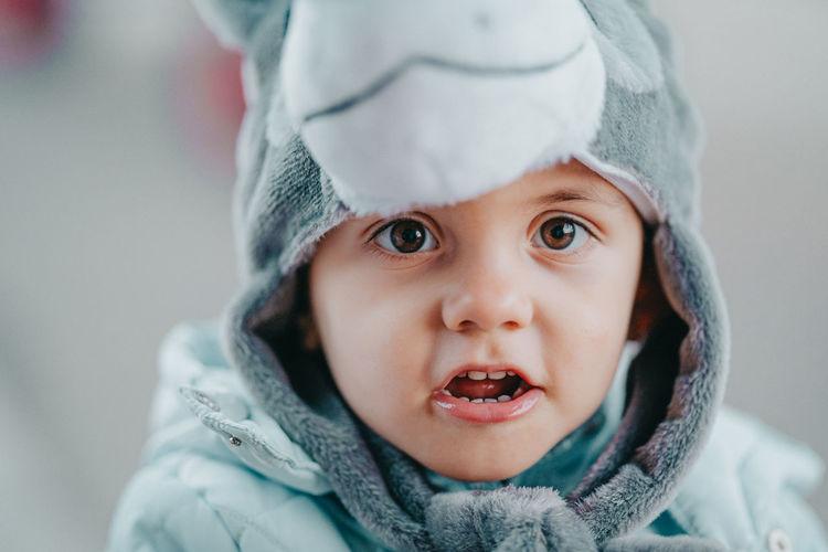Portrait of cute boy in warm clothing