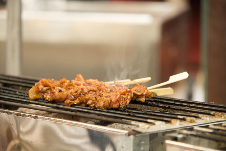 Kebabs on barbecue grill for sale at market