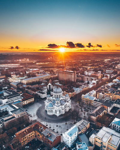 Sunset Drone  Aerial View Aerial Mavic 2 Mavic 2 Pro Europe Lietuva Architecture Soboras Church City Life Sunset Building Exterior Built Structure Cityscape Sky Building Residential District Nature No People High Angle View Orange Color Sun Sunlight Travel Destinations Sunbeam Lens Flare Outdoors