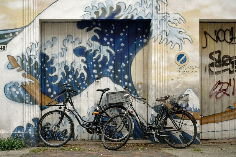 Bicycles on graffiti wall