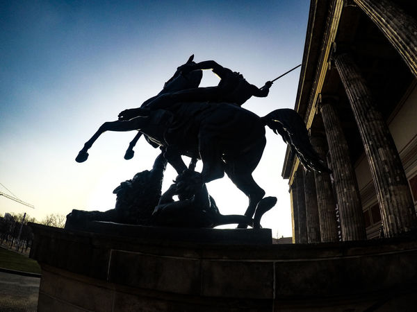 Knight at the end of the day Berlin Berlin Photography Berlin Museuminsel Architecture Building Exterior Built Structure City Clear Sky Day Germany Human Representation Low Angle View No People Outdoors Sculpture Sky Statue Travel Destinations Turism