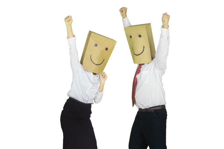 Low angle view of two people against white background