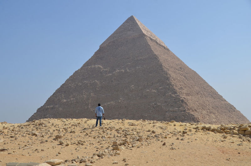 Man Standing Against Pyramid