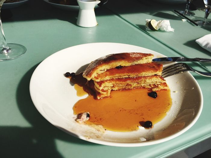 High angle view of eaten pancakes in plate on table
