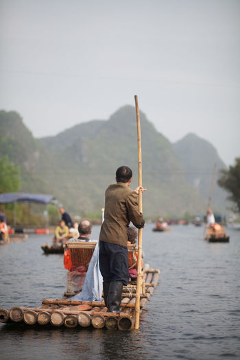 Tourists enjoying in a wooden raft