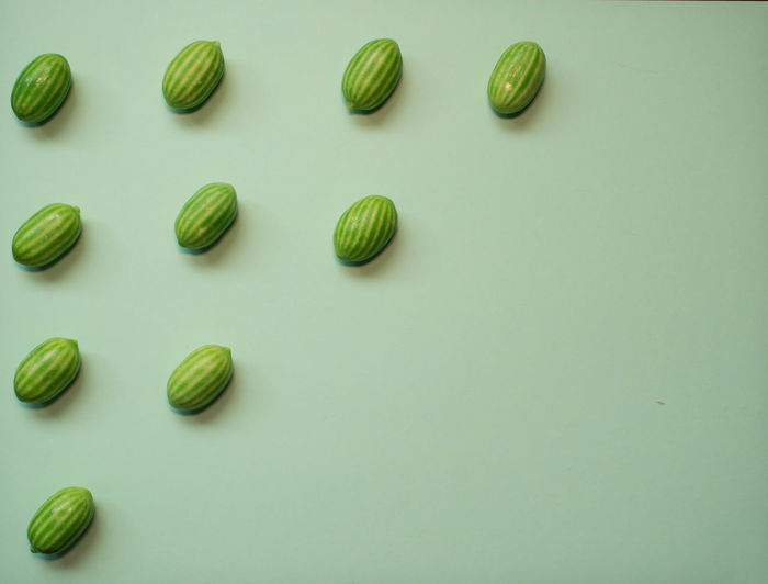 High angle view of candies on white background