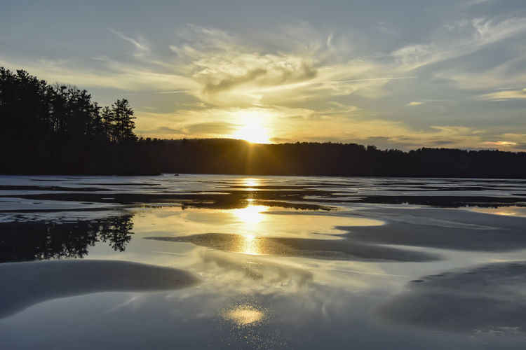 Photos I've captured in the Berkshires, Ma, USA. 2018 was my first year of shooting with a DSLR. I couldn't do wrong in New England. Such a beautiful place. Sky Sunset Water Cloud - Sky Beauty In Nature Tranquility Reflection Scenics - Nature Tranquil Scene Nature Tree Lake Idyllic Sun Orange Color Ice Cold Temperature Silhouette No People Surface Level Kevin Giambertone EyeEmNewHere