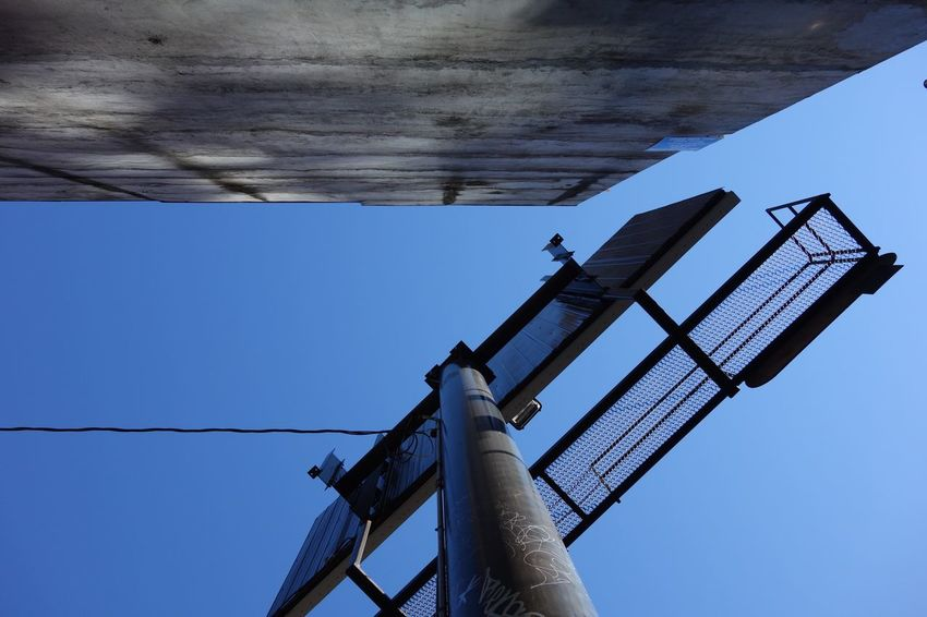 Billboard Blue Clear Sky Connection Day Low Angle View No People Outdoors Power Supply Sky Technology