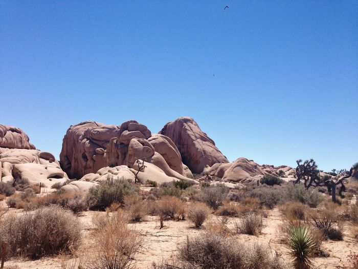 Scenic view of eroded rocks at arid landscape