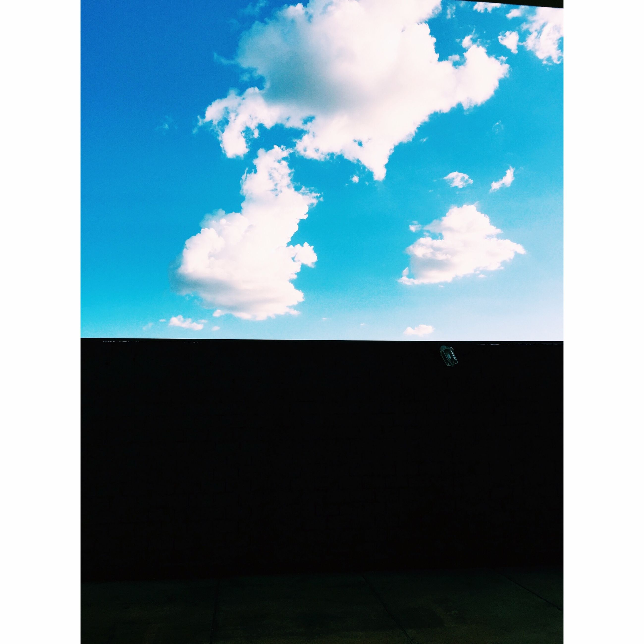 transfer print, sky, blue, auto post production filter, cloud, tranquility, scenics, cloud - sky, tranquil scene, beauty in nature, silhouette, nature, copy space, outdoors, low angle view, no people, dark, idyllic, cloudy, day