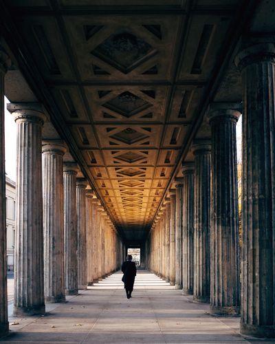 Man walking in corridor of historic building